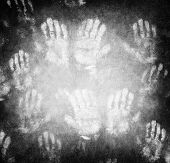Imprint of human hands, black horror background, conceptual image of war and poverty, need help and