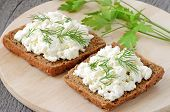 stock photo of curd  - Sandwiches with curd cheese and dill on cutting board - JPG