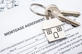 foto of rental agreement  - Mortgage loan agreement application with house shaped keyring