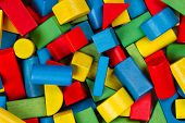 stock photo of wood pieces  - Toys blocks multicolor wooden building bricks heap of colorful game pieces - JPG