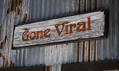 image of hashtag  - Old gone viral sign on tin side wall - JPG