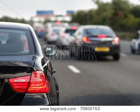 Rush hour traffic congestion focus on tail brake light