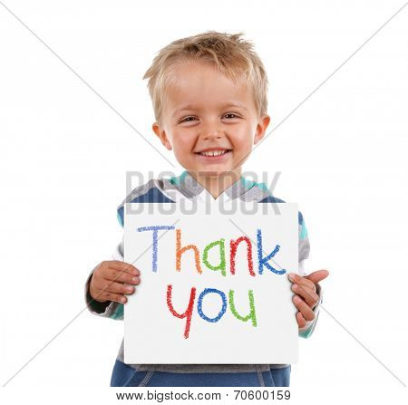 Child holding a crayon thank you sign standing against white background