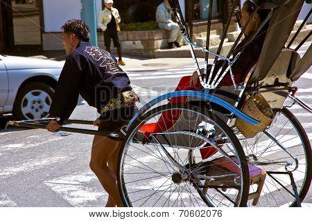 Tourists take a rickshaw ride to explore the city