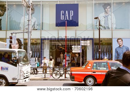 Pedestrians walk past the GAP Store in Harajuku street ,Japan