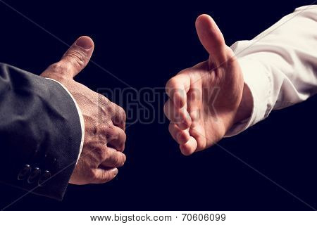 Two Businessmen About To Shake Hands
