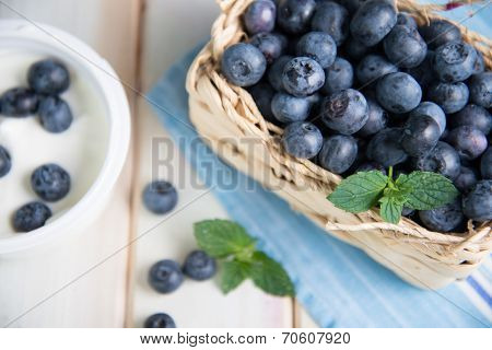 Fresh Blueberries In Basket On Kitchen Table