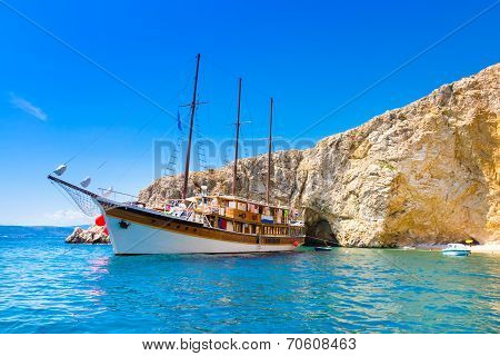 Vintage sailing boat in bay.