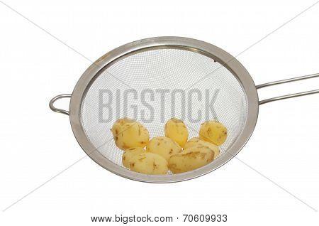 Potatoes In Sieve