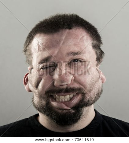 Ugly man with fat cheeks and beard portrait