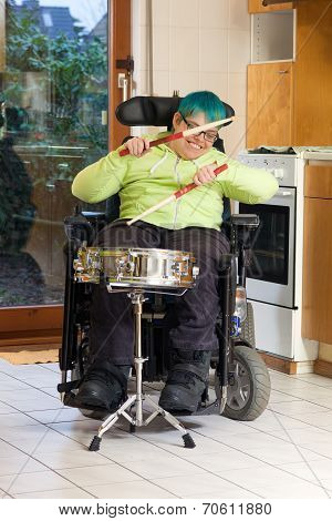 Young Woman With Cerebral Palsy Playing A Drum