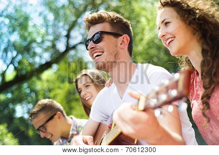 Friends having fun with guitar