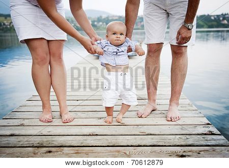 Family feet on pier