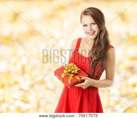 Autumn Present Gift Box, Smiling Woman Holding Presents Over Fall Leaves Yellow Background
