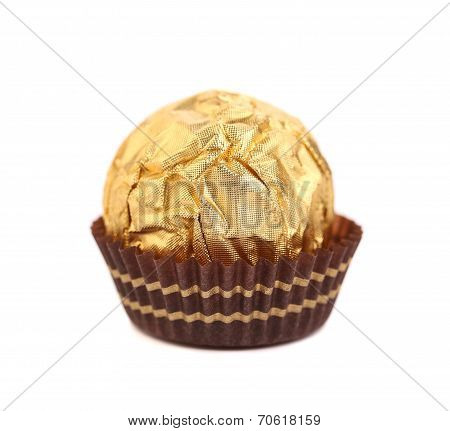 Tasty chocolate bonbon in golden foil.