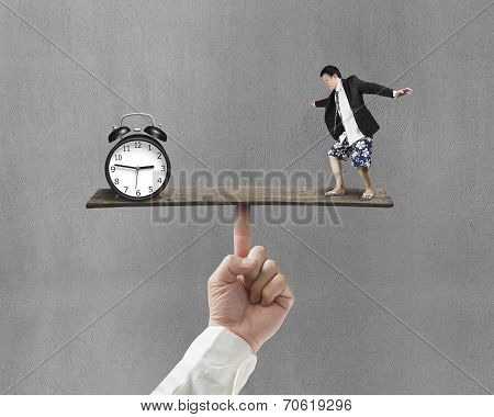 Man Standing On Finger Seesaw Vs Clock