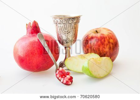 Rosh hashana Kiddush cup pomegranate and sliced apple