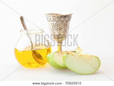 Kiddush cup honey and sliced apple for Rosh hashana