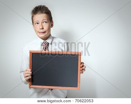 Funny schoolboy with empty chalkboard