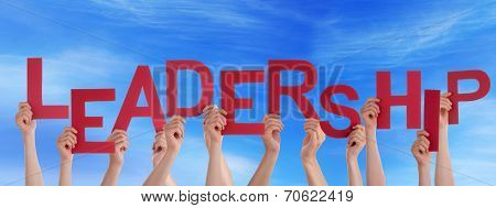 Hands Holding Leadership in front of the Sky