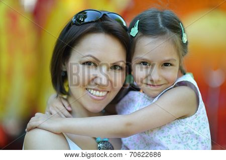 Mother with daughter walk in summer