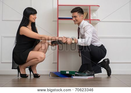 Portrait of young business couple flirting near the office cabin