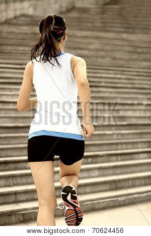 Runner athlete running on stairs. woman fitness jogging workout wellness concept.  Save Download Pr