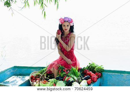 woman on the boat with vegetables