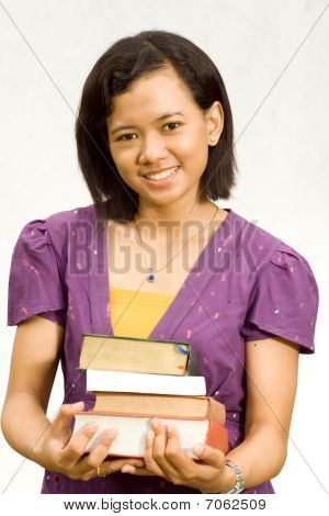 Asian Young Librarian With Stack Of Literature On Hands