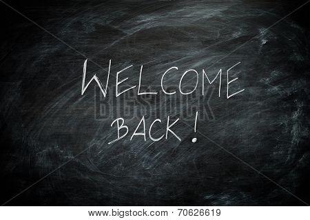 Welcome Back Written On A Blackboard