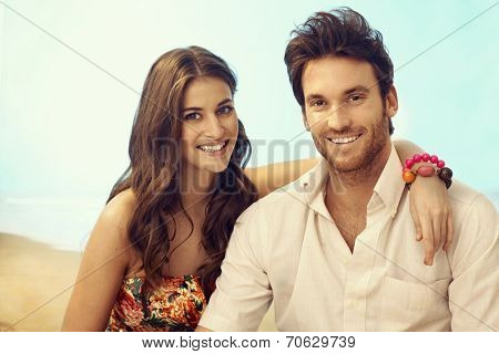 Portrait of young happy casual caucasian couple on vacation. Attractive woman and handsome man, smiling, looking at camera, outdoor, copyspace.
