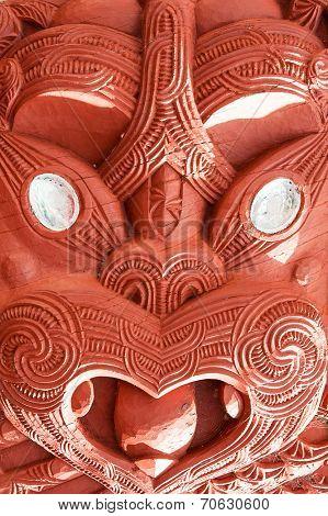 Beautiful maori carving. Detail of the historic meeting house Tamatekapua, Rotorua, New Zealand
