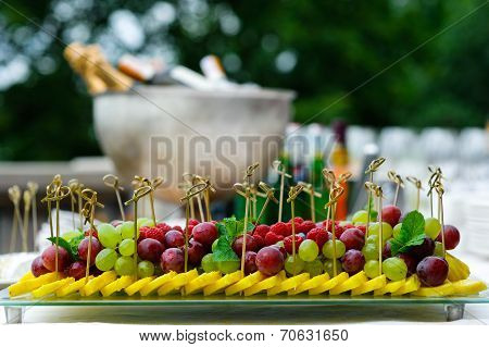 Platter of assorted fresh fruit at buffet table