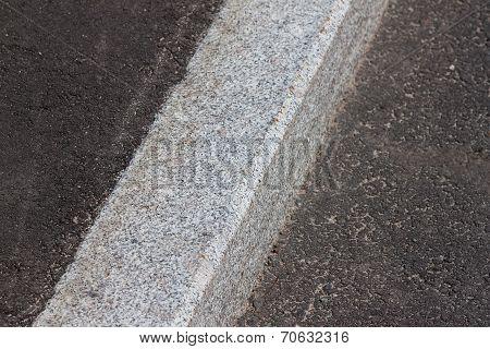 White Curb And Asphalt Road