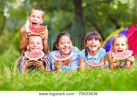 Group Of Happy Kids Eating Watermelons