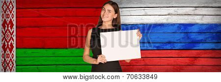 Businesswoman holding paper sheet