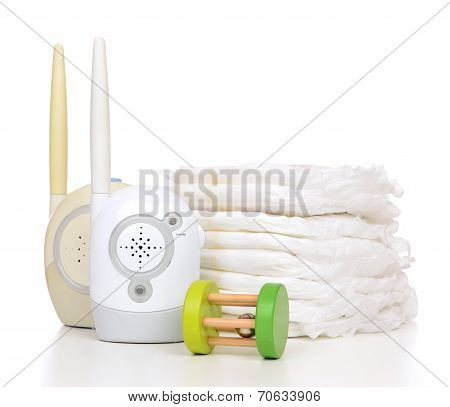 Child Baby Kid Radio Monitor Device Stack Of Diapers And Baby Toy