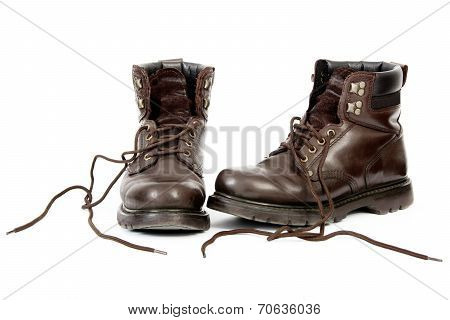 Untied Work Boots After a Day's Work, Isolated on White Background