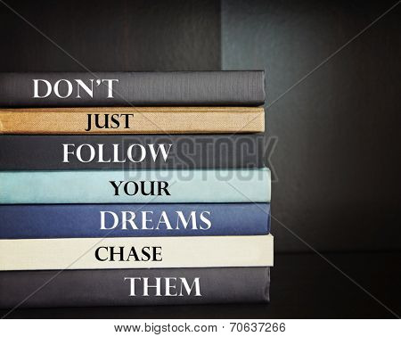 an inspirational quote by unknown source on blue background with a stack of books