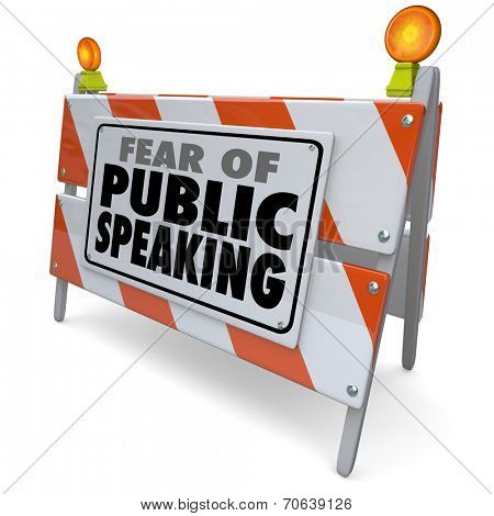 Fear of Public Speaking words on a road construction barrier or barricade illustrating anxiety or stress over delivering a speech at a big event, meeting or convention