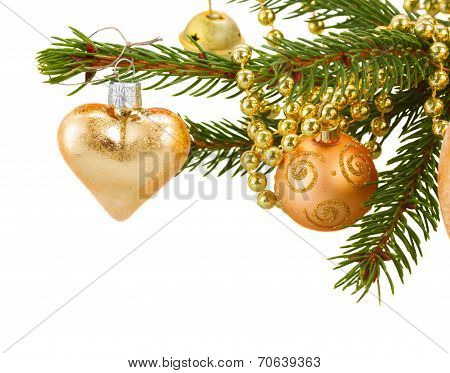 golden christmas decorations   on fir tree