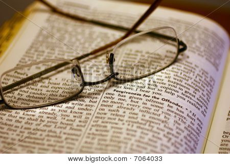 Open Bible with reading glasses