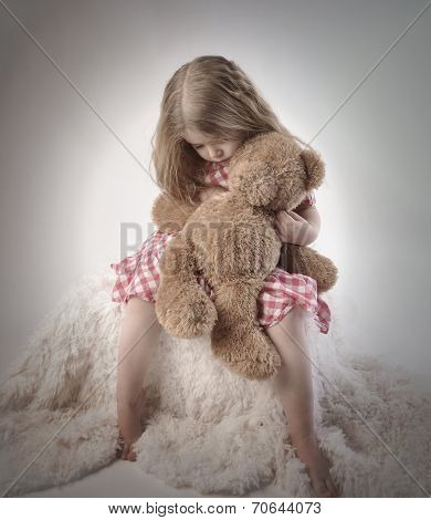 Sad Little Girl Holding Teddy Bear