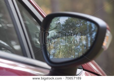 Reflected In The Car Mirror