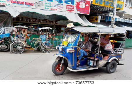 Tuk Tuk Or Sam-lor Run Through The Streets