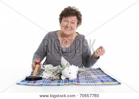 Happy Older Woman - Rich Person After Smashing Piggy Bank.