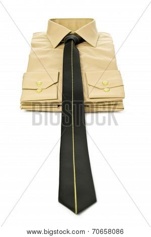Stack of yellow man's shirt and tie
