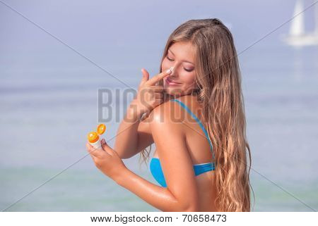 sun protection woman with suntan lotion or cream