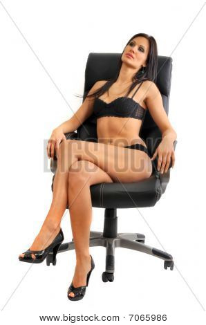 Sexy Young Woman Posing In Leather Chair