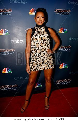 NEW YORK-AUG 13: Singer Mel B attends the backstage post-show red carpet for NBC's 'America's Got Talent' Season 9 at Radio City Music Hall on August 13, 2014 in New York City.